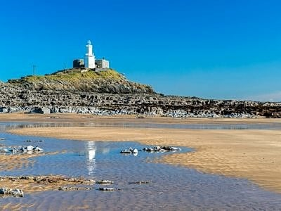 Mumbles Lighthouse and Bracelet Bay Swansea South Wales