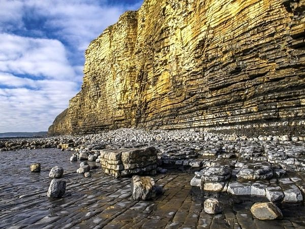Llantwit Major Beach sunlit cliffs