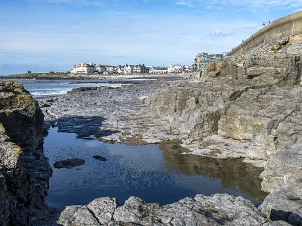 Porthcawl Seafront across a Rock Pool