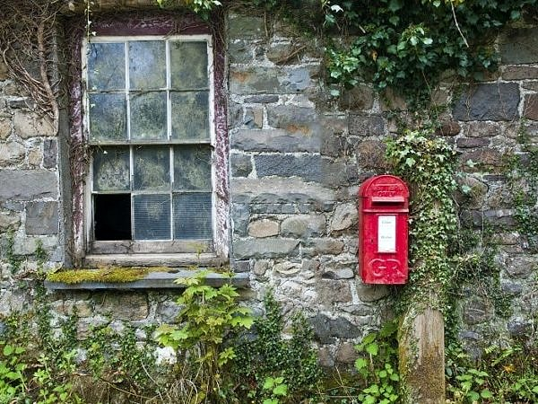 Old Building and red letterbox on the roadside Cilycwm