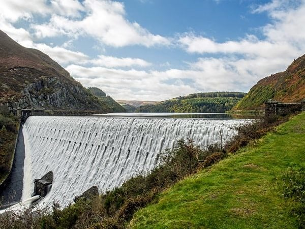 Caban Coch Dam with Cascading Water Elan Valley
